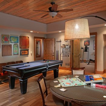 The terrace level (basement) game room is perfect for keeping family and friends entertained. Just beyond the game room is a well outfitted exercise room.