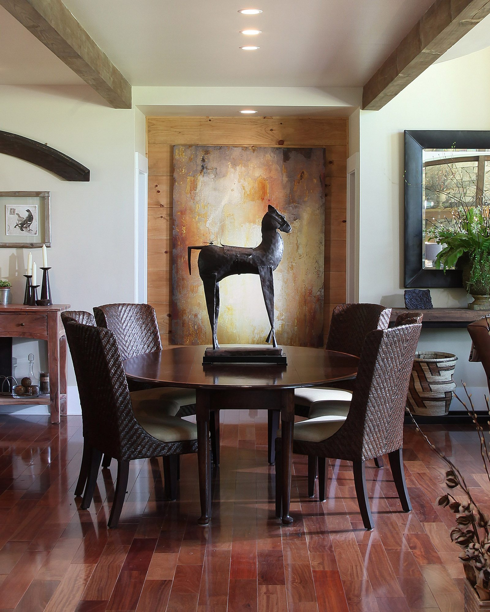 ower ceiling in the dining area helps define the space